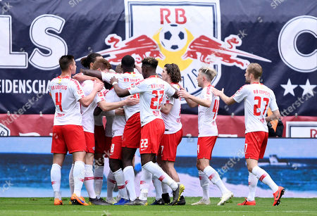 Leipzig's players celebrate after their teammate Timo Werner scored the opening goal during the German Bundesliga soccer match between RB Leipzig and SC Freiburg in Leipzig, Germany