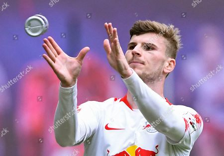 Leipzig's Timo Werner celebrates after scoring the opening goal during the German Bundesliga soccer match between RB Leipzig and SC Freiburg in Leipzig, Germany