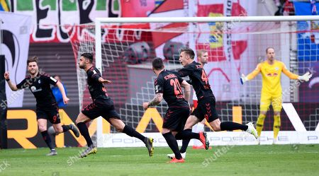 Freiburg's Vincenzo Grifo, 2nd left, celebrates after scoring a goal during the German Bundesliga soccer match between RB Leipzig and SC Freiburg in Leipzig, Germany
