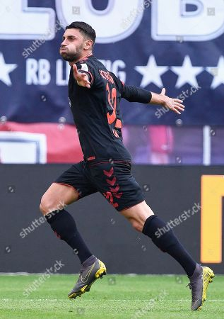 Freiburg's Vincenzo Grifo celebrates after scoring a goal during the German Bundesliga soccer match between RB Leipzig and SC Freiburg in Leipzig, Germany