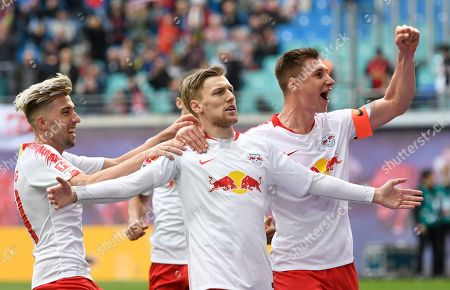 Leipzig's Emil Forsberg, 2nd right, celebrates after scoring a goal during the German Bundesliga soccer match between RB Leipzig and SC Freiburg in Leipzig, Germany