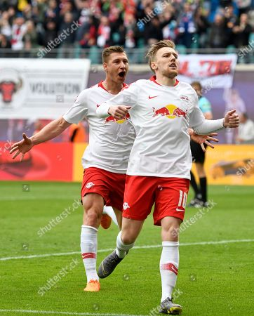 Leipzig's Emil Forsberg, right, celebrates scoring a goal during the German Bundesliga soccer match between RB Leipzig and SC Freiburg in Leipzig, Germany
