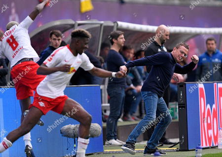 Leipzig's head coach Ralf Rangnick, right, celebrates during the German Bundesliga soccer match between RB Leipzig and SC Freiburg in Leipzig, Germany, . Leipzig won by 2-1