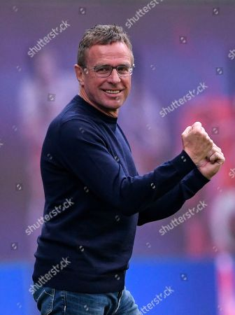 Leipzig's head coach Ralf Rangnick celebrates during the German Bundesliga soccer match between RB Leipzig and SC Freiburg in Leipzig, Germany, . Leipzig won the match 2-1