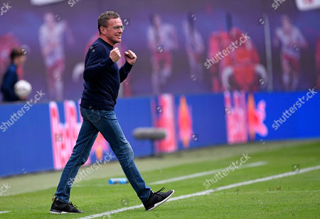 Leipzig's head coach Ralf Rangnick celebrates during the German Bundesliga soccer match between RB Leipzig and SC Freiburg in Leipzig, Germany