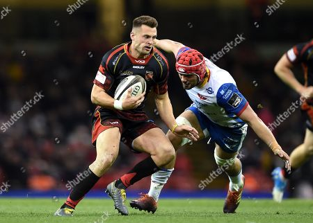 Josh Lewis of Dragons gets past Josh Macleod of Scarlets.