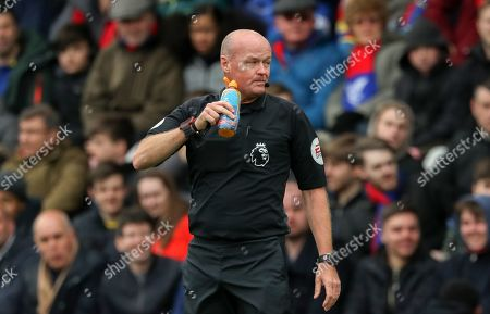 Referee Lee Mason takes a Drinks Break
