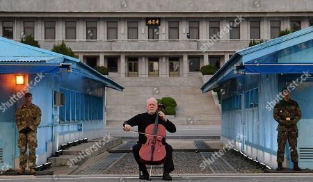 American cellist Lynn Harrell perform during a ceremony to mark the first anniversary of Panmunjom declaration between South Korean President Moon Jae-in and North Korean leader Kim Jong-un at the Joint Security Area (JSA) on the Demilitarized Zone (DMZ) in the border village of Panmunjom in Paju, South Korea, 27 April 2019. The Panmunjom Declaration was adopted during the inter-Korean summit on 27 April 2018 aimed at cooperating on officially ending the Korean War and the Korean conflict, as well as includes the denuclearization of the Korean Peninsula.