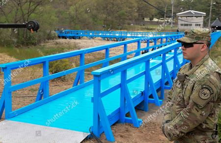 A US soldier stands guards on the Blue bridge while a marking the first anniversary of Panmunjom declaration between South Korean President Moon Jae-in and North Korean leader Kim Jong-un at the Joint Security Area (JSA) on the Demilitarized Zone (DMZ) in the border village of Panmunjom in Paju, South Korea, 27 April 2019. The Panmunjom Declaration was adopted during the inter-Korean summit on 27 April 2018 aimed at cooperating on officially ending the Korean War and the Korean conflict, as well as includes the denuclearization of the Korean Peninsula.