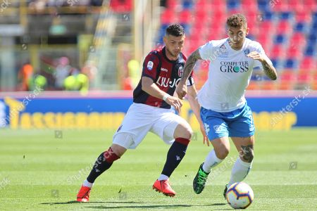 "Bolognas Blerim Dzemaili (L) and Empoli's Giovanni Di Lorenzo in action during the Italian serie A Tim soccer match Bologna Fc vs Empoli at ""Dall'Ara"" stadium in Bologna, Italy, 27 April 2019."