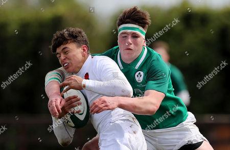 Ireland U18 Clubs & Schools vs England U18 Counties. England's Max Brown is tackled by Joseph McCarthy of Ireland