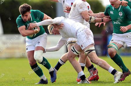 Ireland U18 Clubs & Schools vs England U18 Counties. Ireland's Jack Delaney is tackled by Jacob Bailey of England