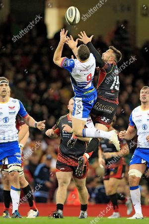 Gareth Davies of Scarlets (left) and Jordan Williams of Dragons rise to take a high ball