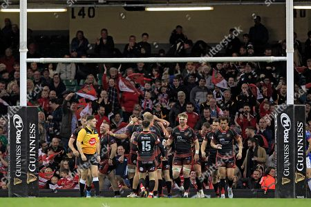 Stock Image of Dragons celebrate scoring their third try scored by Josh Lewis
