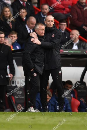 Chris Wilder manager of Sheffield United hugs Alan Knill.