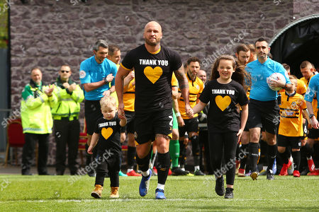 David Pipe of Newport County leads out the team following his announcement to retire