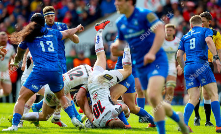 Ulster vs Leinster. Ulster's Johnny McPhillips and Peter Nelson with Noel Reid of Leinster