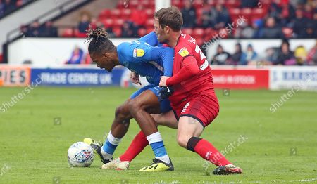 Ivan Toney of Peterborough United battles for possession with Scott Laird of Walsall