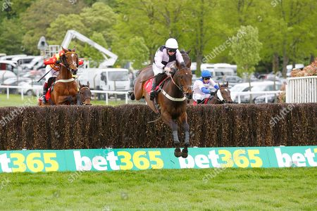 Stock Picture of Larry and Jamie Moore win a thrilling Bet365 Josh Gifford Novices' Handicap Chase at Sandown.