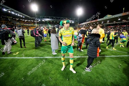 Norwich City midfielder Ben Godfrey (4) celebrates promotion to the Premier League after the EFL Sky Bet Championship match between Norwich City and Blackburn Rovers at Carrow Road, Norwich