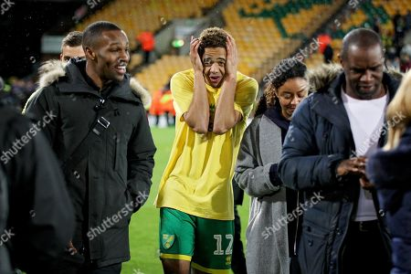 Norwich City defender Jamal Lewis (12) celebrates promotion to the Premier League after the EFL Sky Bet Championship match between Norwich City and Blackburn Rovers at Carrow Road, Norwich