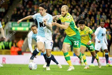 Norwich City forward Teemu Pukki (22)  and Blackburn Rovers defender Lewis Travis (27)   during the EFL Sky Bet Championship match between Norwich City and Blackburn Rovers at Carrow Road, Norwich