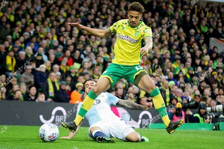 Norwich City defender Jamal Lewis (12) rides this challenge during the EFL Sky Bet Championship match between Norwich City and Blackburn Rovers at Carrow Road, Norwich