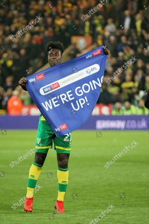 Norwich City midfielder Alexander Tettey (27) celebrates with EFL flag after the EFL Sky Bet Championship match between Norwich City and Blackburn Rovers at Carrow Road, Norwich