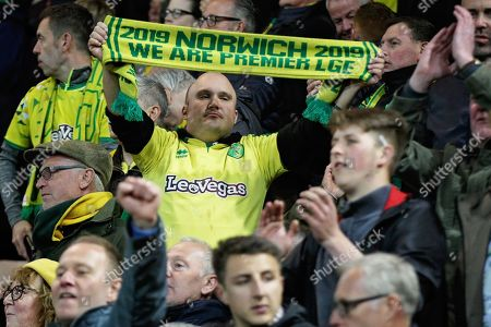 Stock Image of Norwich City fans with a Premier League scarf celebrating promotion after the EFL Sky Bet Championship match between Norwich City and Blackburn Rovers at Carrow Road, Norwich