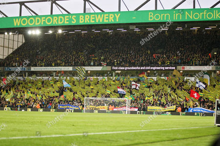 Stock Photo of Norwich City fans in a celebratory mood before the EFL Sky Bet Championship match between Norwich City and Blackburn Rovers at Carrow Road, Norwich