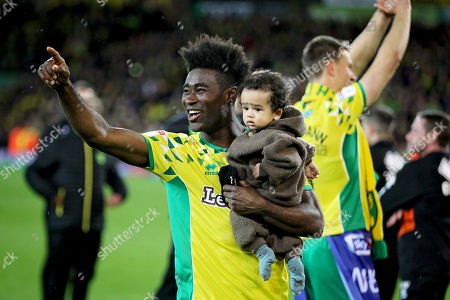 Norwich City midfielder Alexander Tettey (27)  celebrates promotion to the Premier League after the EFL Sky Bet Championship match between Norwich City and Blackburn Rovers at Carrow Road, Norwich