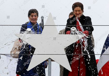 Luci Baines Johnson, Lynda Johnson Robb. Luci Baines Johnson, left, and her sister, Lynda Johnson Robb, smash champagne bottles to christen the Lyndon B. Johnson, the third Zumwalt-class guided missile destroyer, built at Bath Iron Works, in Bath, Maine. Johnson and Robb and the daughters of the former president