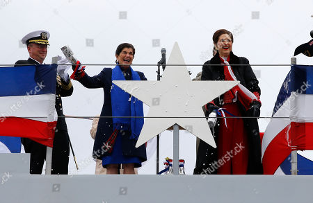 Stock Photo of Luci Baines Johnson, Lynda Johnson Robb. Luci Baines Johnson, left, and her sister, Lynda Johnson Robb, acknowledge the crowd after christening the Lyndon B. Johnson, the third Zumwalt-class guided missile destroyer, built at Bath Iron Works, in Bath, Maine. Johnson and Robb and the daughters of the former president