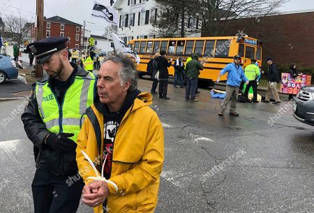 Luci Baines Johnson, Lynda Johnson Robb. A protester is arrested outside Bath Iron Works prior to the christening ceremony for a Zumwalt-class guided missile destroyer named for former President Lyndon Baines Johnson, in Bath, Maine