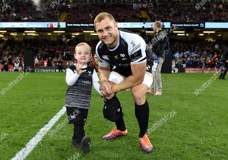 James King of Ospreys with son.