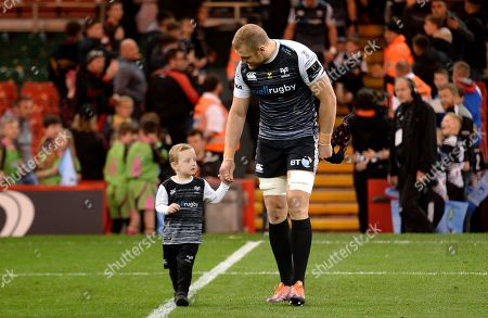 James King of Ospreys with his son.