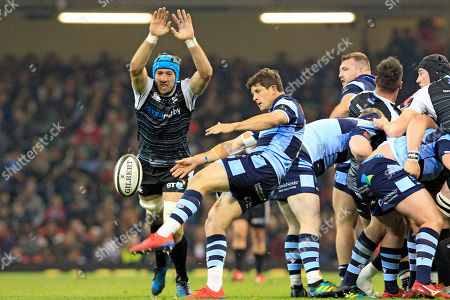 Lloyd Williams of Cardiff Blues kicks clear as Justin Tipuric  of Ospreys closes in