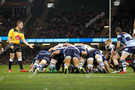 Referee Nigel Owens (left) keeps an yet on the scrum