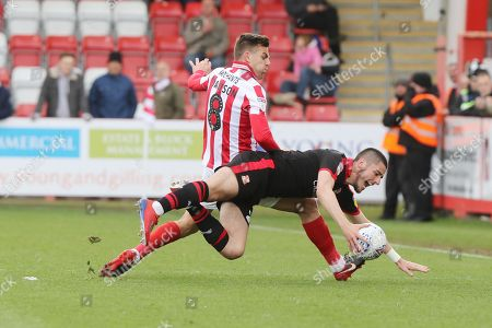 Kevin Dawson and Canice Carroll   during the EFL Sky Bet League 2 match between Cheltenham Town and Swindon Town at LCI Rail Stadium, Cheltenham