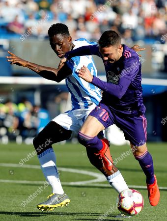 CD Leganes' Nigerian defender Kenneth Omeruo (L) duels for the ball with Celta's striker Aspas Iago Aspas (R) during their Spanish LaLiga Primera Division soccer match played at the Butarque stadium in Madrid, Spain, 27 April 2019.