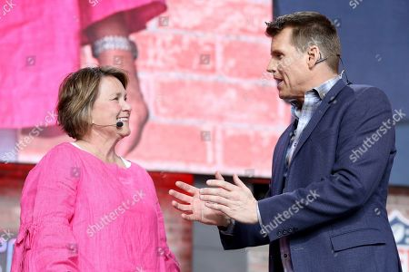 Tennessee Titans controlling owner Amy Adams Strunk is seen with NFL RedZone host Scott Hanson on Day 3 of the NFL football draft, in Nashville, Tenn. on