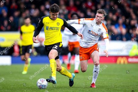 Ben Fox of Burton Albion takes on Jack Stacey of Luton Town