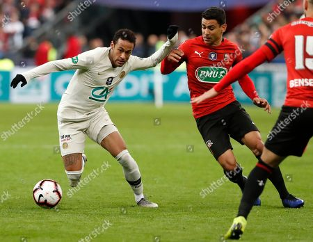 Rennes' Benjamin Andre, right, challenges PSG's Neymar, left, during the French Cup soccer final between Rennes and Paris Saint Germain at the Stade de France stadium in Saint-Denis, outside Paris, France
