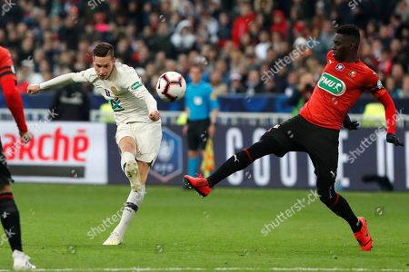 Rennes' M'baye Niang, right, challenges PSG's Julian Drexler, left, during the French Cup soccer final between Rennes and Paris Saint Germain at the Stade de France stadium in Saint-Denis, outside Paris, France