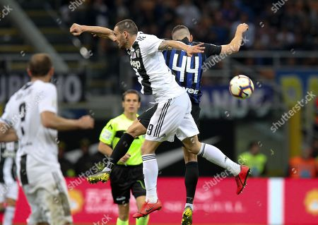 Stock Image of Inter's Ivan Perisic (R) and Juventus' Leonardo Bonucci in action during the Italian Serie A soccer match FC Inter vs Juventus FC at the Giuseppe Meazza stadium in Milan, Italy, 27 April 2019.