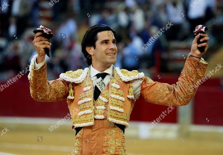 Spanish bullfighter Alberto Lopez Simon celebrate after cutting two ears to his second bull during the 2nd bullfighting of the Minifair of San Jorge held at La Misericordia bullring in Zaragoza, northern Spain, 27 April 2019.