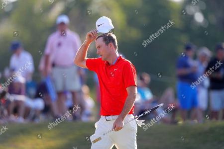 Stock Image of Russell Henley walks off the 17th tee during the third round of the PGA Zurich Classic golf tournament at TPC Louisiana in Avondale, La