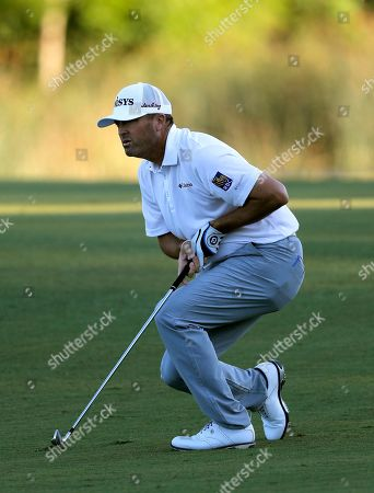 Ryan Palmer reacts after his shot on the 18th fairway during the third round of the PGA Zurich Classic golf tournament at TPC Louisiana in Avondale, La