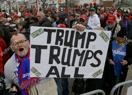 President Donald Trump supporter, Jammer Batzler. shows his support as he waits to get in to a rally to hear him speak, in Green Bay, Wis
