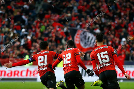 Benjamin Andre(L), James Lea Siliki (C) and Ramy Bensebaini (R) of Rennes celebrate after winning the Coupe de France soccer final match between Stade Rennais and Paris Saint Germain (PSG), in Saint-Denis near Paris, France, 27 April 2019.